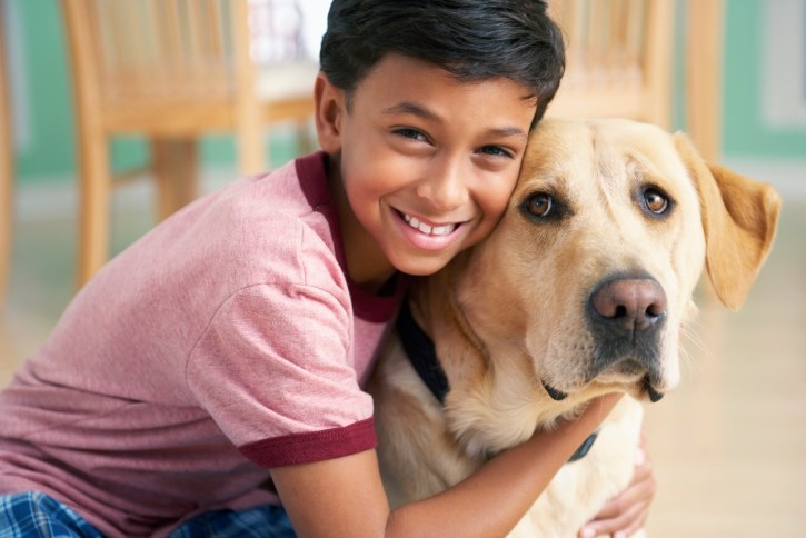 The companionship of a dog may lower a child's anxiety levels.