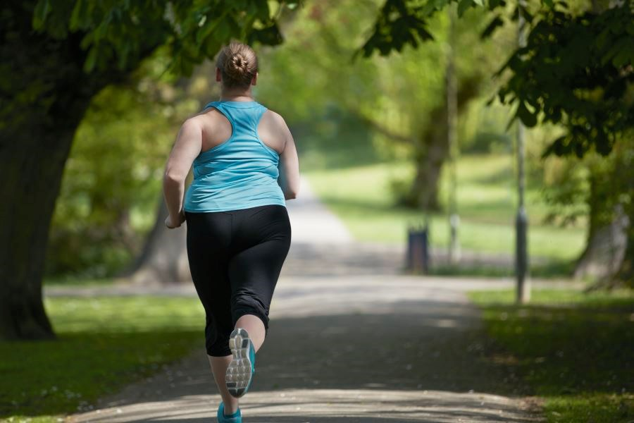 Exercise Modifies Predisposition to Obesity After Menopause